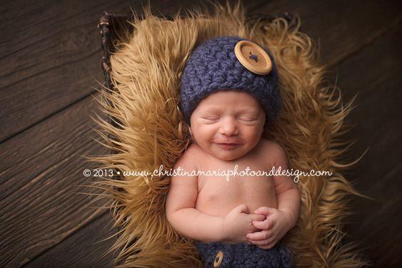 Newborn baby boy smiles | michigan newborn photographer