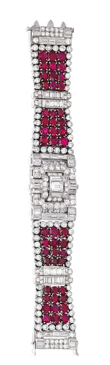 PLATINUM, RUBY AND DIAMOND BRACELET, CARTIER, LONDON.  The flexible strap set with 48 round and oval-shaped rubies weighing approximately 29.00 carats, centered by a rectangular diamond weighing approximately 1.25 carats, accented by round and baguette diamonds weighing approximately 19.65 carats, length 6¾ inches, signed Cartier London, numbered 04132; circa 1935.