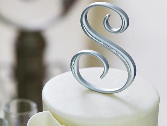 Why not customize your wedding cake with a stylish monogram cake topper from Michaels? Makes for a great keepsake.