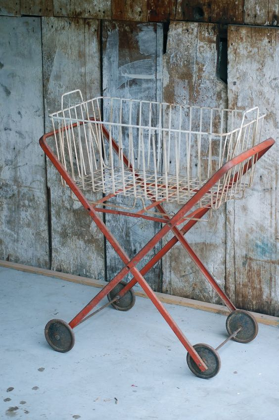 cart~ I have this one! I replaced the white wire basket with the Longaberger laundry basket and it is adorable!