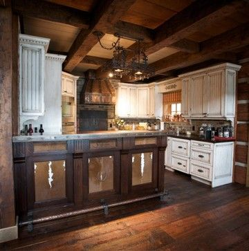Love the cowhide inset cabinets with the rusty horseshoe Western kitchen cabinets