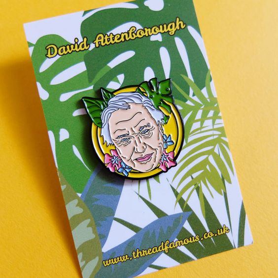 David Attenborough pin badge. The living legend of travel and nature documentaries, this hero deserves a spot on your lapel! 10% of the sale price of each pin will be donated to WWF (the World Wide Fund for Nature), so your purchase could help the conservation of endangered animals, the replanting of forests, or the prevention of animal smuggling.   Each pin is 30mm at longest point, soft enamel on black dyed metal. Rubber clutch back clasp. This product is an unofficial item. Some colours…