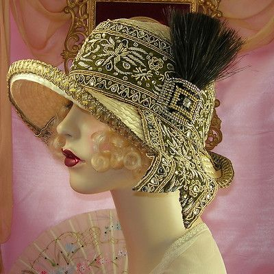 1920's feather beaded buckle flapper cloche hat.