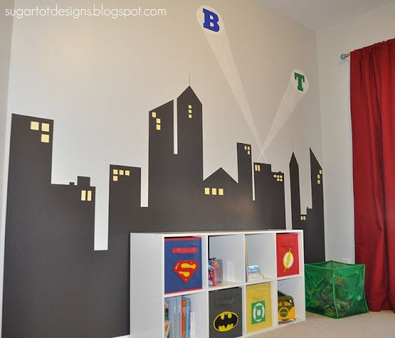 Superhero bookcase made simple by use of canvas pull out bins.  When we outgrow the superhero theme, this bookcase can be reused just by replacing the bins.