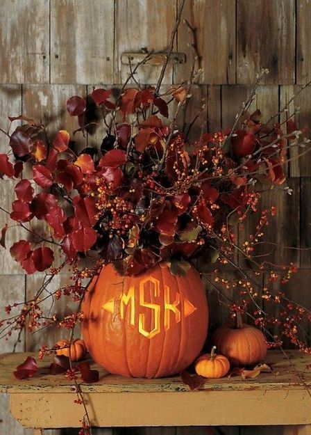 wishing we had the skills to carve this monogramed pumpkin..