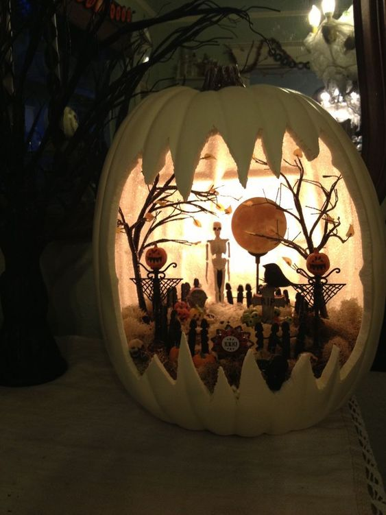 The Spooky World of Halloween Pumpkin Dioramas ~ Now this kind of looks like dusk since the inside is painted white. But the skeleton looks just as menacing from the shadows.