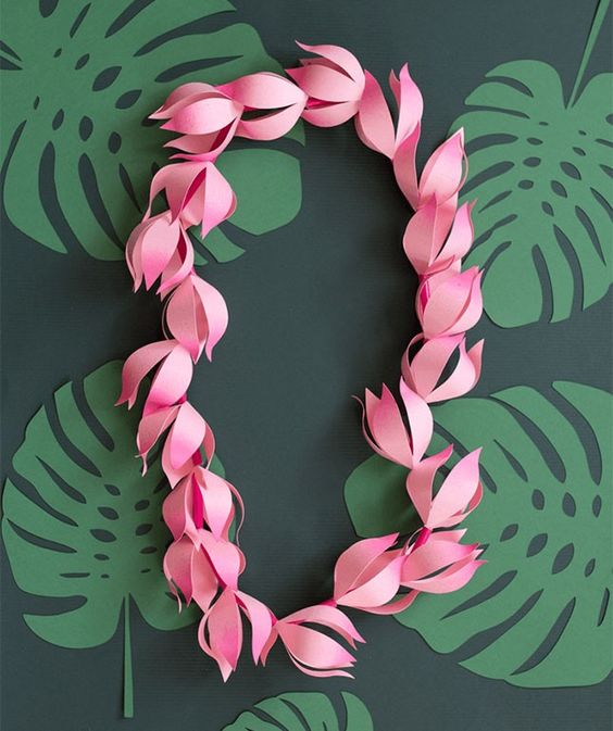 Love this easy DIY paper lei as an accessory to wear at your summer tropical-themed 30th birthday pool party.