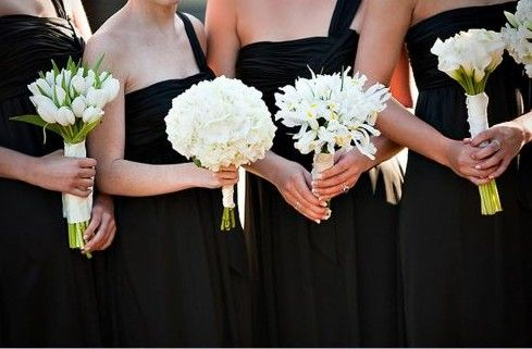 I love the idea of different varieties of flowers for bridesmaids all in the same uniting color.  #whitewedding #weddingbouquet