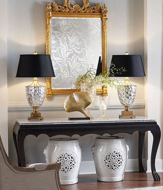 We call this design, Console Table Heaven ❤❤❤. Shown here is our Christopher Table Lamp, White Lion Garden Seats and our fit for a queen 👸 Empire Style Gilded Mirror. Discover the look by clicking our link in profile.: