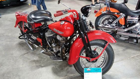 Vintage red and black springer harley davidson with a flathead motor.