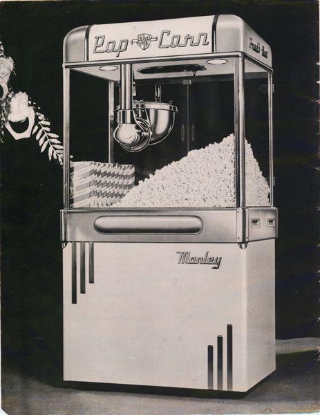 Primeira máquina de pipoca elétrica, inventada por Charles Manley em 1925, que ficou milionário vendendo para todo os cinemas nos Estados Unidos: