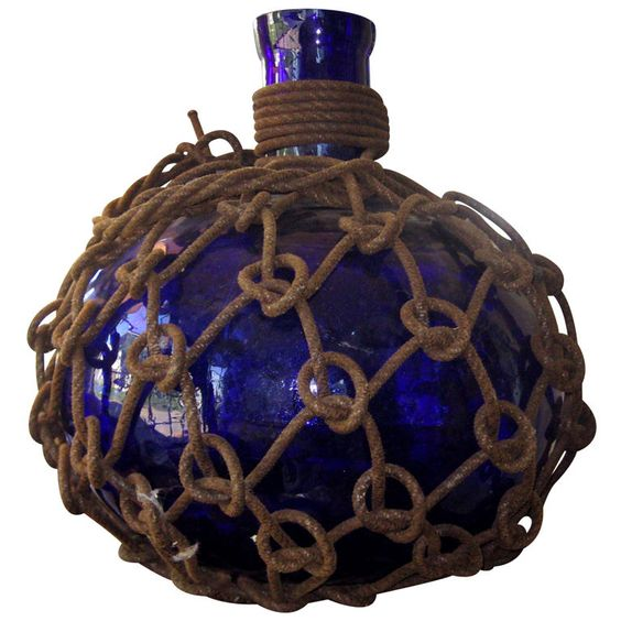 Glass Float  English  19th Century  Cobalt blue glass float with netting