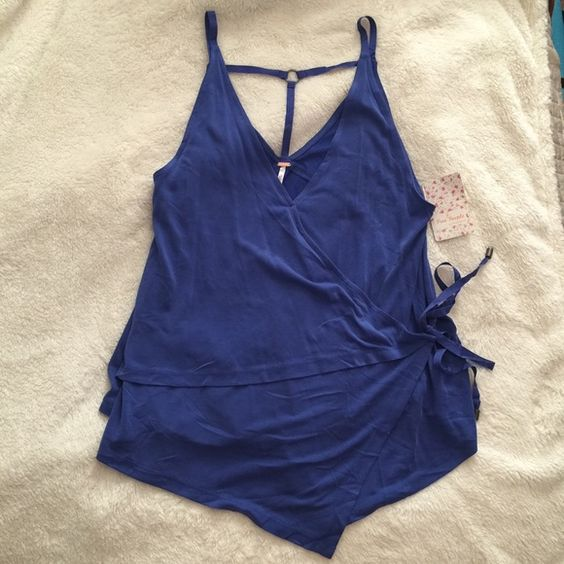 Free People Wrap Top ▪️NWT / Brand New / Never worn ▫️No Trades  Free People Size Small Color: Cobalt Material: Modal-Polyester, so soft!  Fit: See Model Pics  Easy, Soft wrap sleeveless top with strappy ribbon ties and V neck  Currently retailing for $68, so no less than $45 for this piece! PRICE FIRM.  ✨ Free People Tops Tank Tops