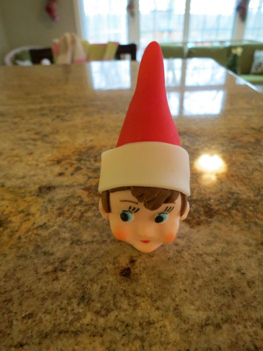 Learn how to make an 'Elf on the Shelf' cake topper here: http://cakejournal.com/tutorials/elf-cake-topper/