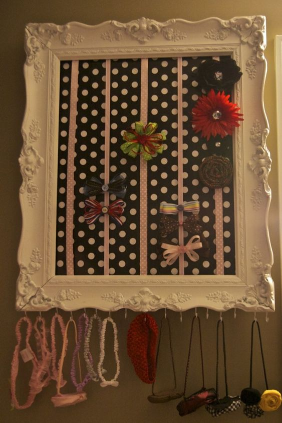 Bow holder: Old picture frame, spray paint, fabric, ribbon, staples, and hooks. Wha-la!! I'll be making one soon :)