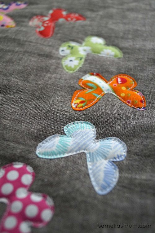 This free motion applique is so cute! Love the pop of color on the gray base.