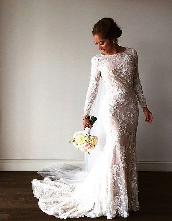 beautiful modest lace wedding dress with long sleeves Photo via Popsugar / http://www.himisspuff.com/long-sleeve-wedding-dresses/4/