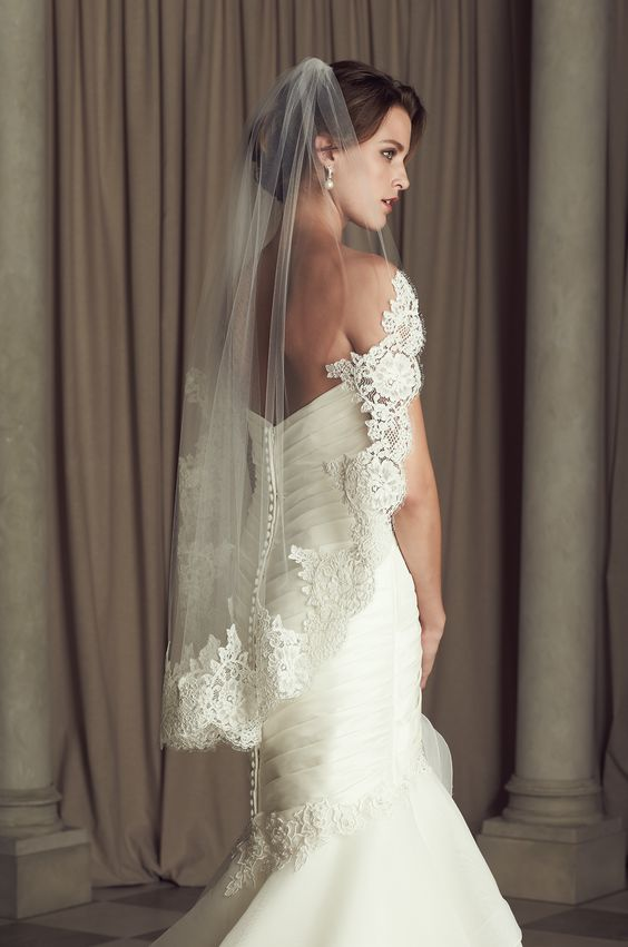 One tier, Fingertip or Chapel length veil with Paloma Re-embroidered Lace edging…: