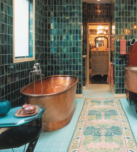 Cool bathroom...love the turquoise tiles and copper tub