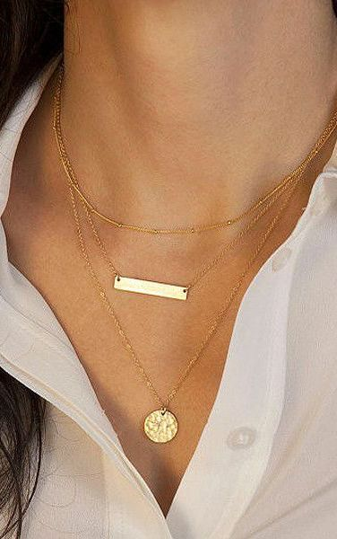 One way to layer this Summer — with your necklaces! Try a dainty layered gold necklace.