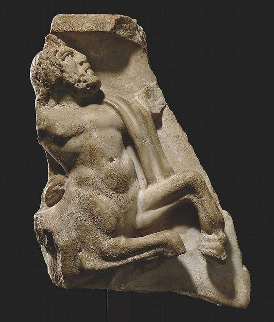 A ROMAN MARBLE SARCOPHAGUS FRAGMENT CIRCA 2ND-3RD CENTURY A.D.