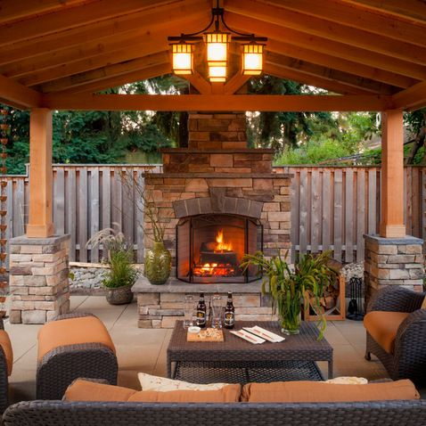 charm of an outdoor living space w grand fireplace