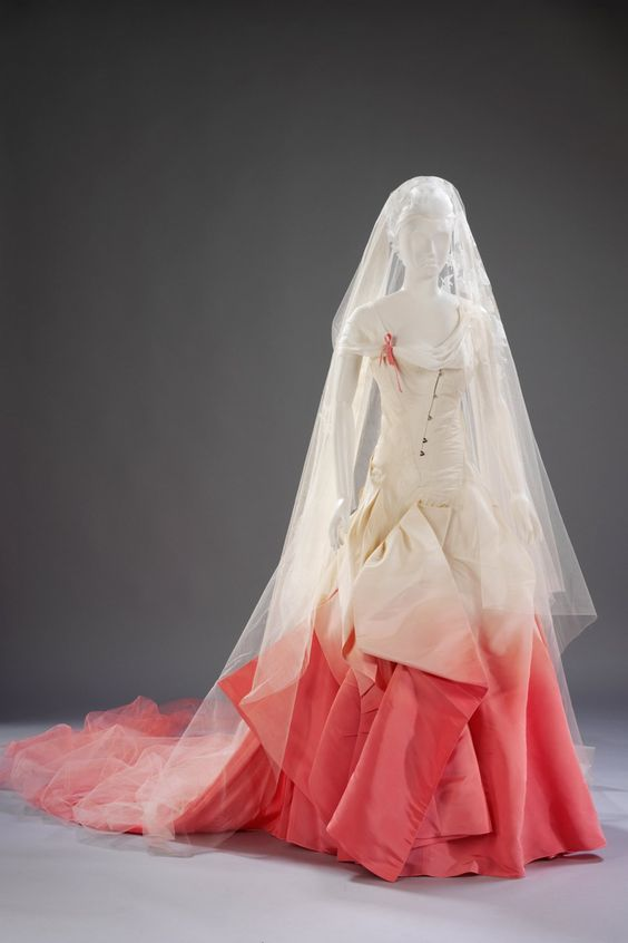 Gwen Stefani's wedding dress  Love all the detail in the bodice and colour
