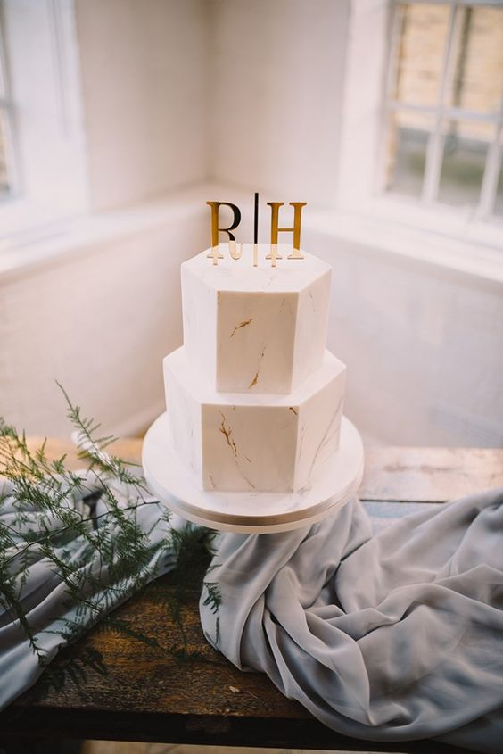 Hollie and Rob fused together two of 2018's biggest wedding trends, marble and copper, for a truly stylish day