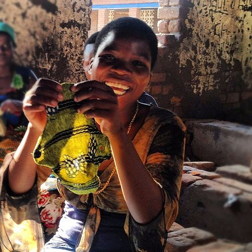 This woman is stunning! These women in Malawi are learning how to make reusable sanitary pads. Photo Credit: Kristi Mathis.