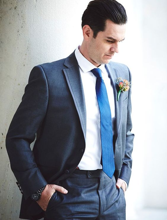 Grey groom tux with navy tie
