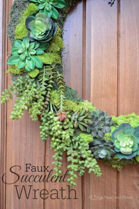This faux succulent wreath is the perfect wreath for your summer porch! Beautiful faux succulents on a moss base, welcome friends all spring/summer long!