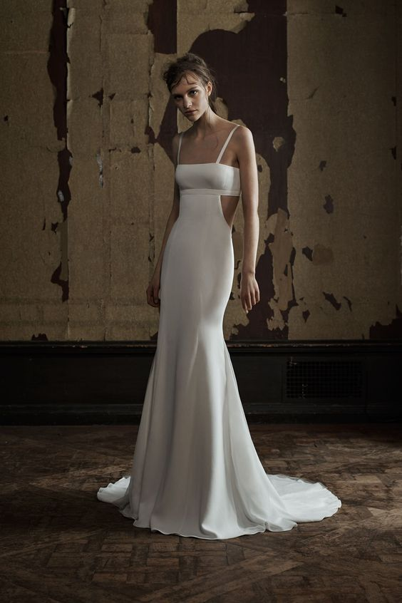 Vera Wang Soft white bra top silk crepe mermaid gown with cutout detail and plunging back accented by satin ribbon straps and French tulle accent on the godes.