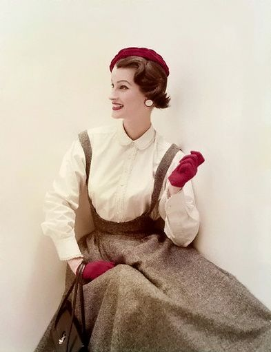 1954  Model is wearing a herringbone tweed pinafore and a white lace tipped broadcloth shirt.