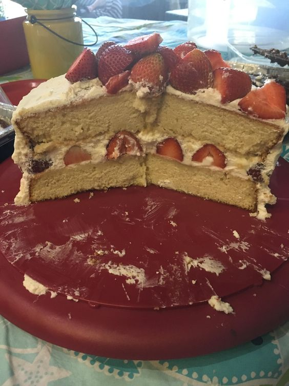 This gorgeous cake is even more amazing when you slice into it, revealing the rows of perfect strawberries.