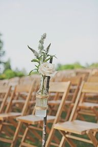 ....a use for those wine bottles ;) I would prefer them hanging with ribbon or twine from chairs - no stick