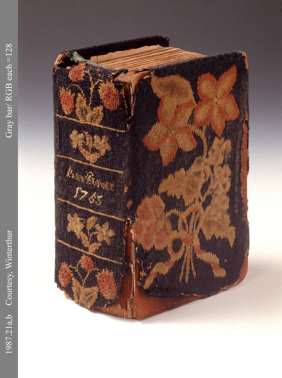 This is a Prayer book cover wrought by Ann Flower in 1765, the year of her marriage to Samuel Wheeler. This difficult piece was worked on canvas with fine crewel yarns, using 'Irish Stitches' to create the covers beautiful flower. >> for more on this extremely rare stitch, click through ....