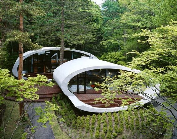 """Every now and again it's nice to sit back and revisit some great architecture that the world's innovators have created. One of those happens to be the beautifully undulating structure by ARTechnic dubbed """"Shell"""" house in Karuizawa, Nagaro Japan.    #travelways #guiddoo  #trave #aroundtheworld  #wanderlust #nomad #smiles #happiness #expressions #LetsExplore #scuba #diving #adventure #underwater #seabed #sea #life www.guiddoo.com"""