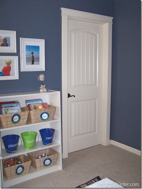 Delightful Order: Organizing an Out of Control Storage Closet -but I love the color of her boy's toy room! What better color than Denim for a boy?