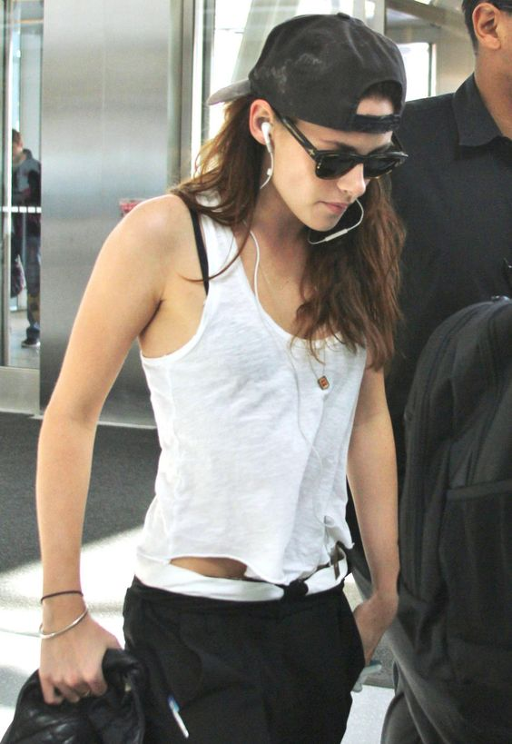 Kristen leaving Toronto today. Sept. 9th. Gold ring...check! Necklace...check! Rob's Orioles baseball cap worn backwards...check! <3 <3