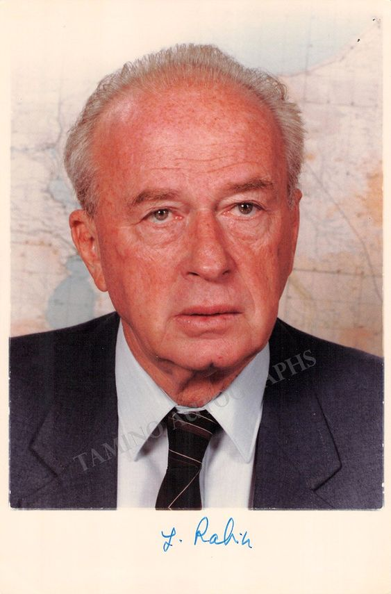 Israeli politician (1922-1995), statesman and general, who served as the fifth Prime Minister of Israel, serving two terms in office, 1974-1977 and 1992 until his assassination in 1995. Nice color photo signed by him. Size is 5 x 7.7 inches, few clip holes over the upper-right corner, otherwise in excellent condition.