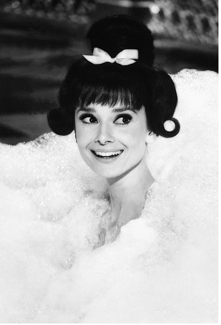 Audrey Hepburn, bathing beauty with a bow on top!:
