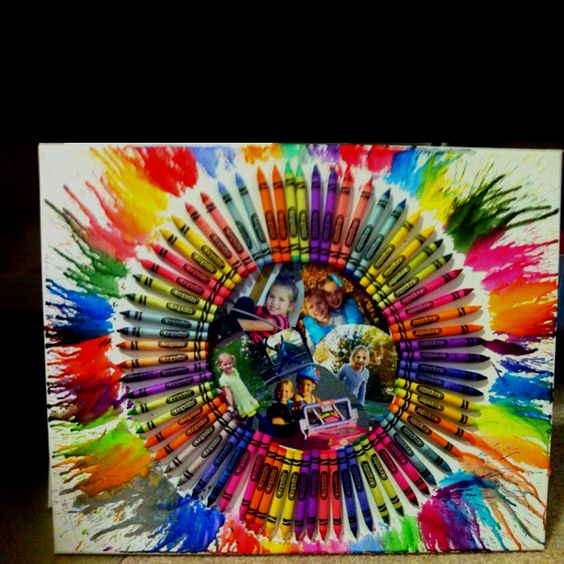 Crayon splatter art with a collage of pictures in the middle
