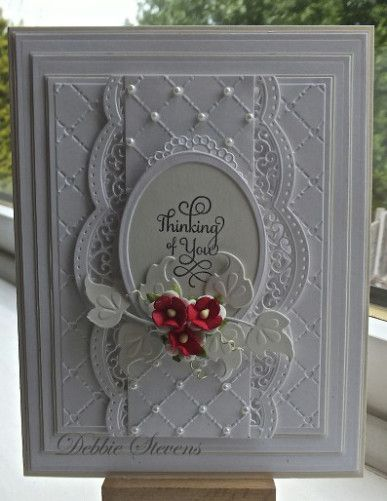 Spellbinders Grand rectangles, Spellbinders A2 scalloped borders, Spellbinder classic ovals large, marianne designs (leaf) justrite hugs and kisses stamp, Sue Wilson heart lattice embossing folder, flowers from Wild orchid crafts