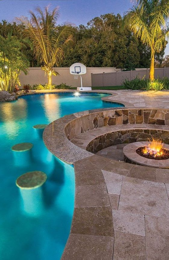 A Firepit Near The Pool Can Be A Great Way To Experience A Jaw Dropping Ambiance And C Backyard Pool Designs Swimming Pools Backyard Backyard Pool Landscaping