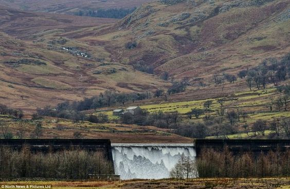The Wet Sleddale Reservoir's wall of water, near the village of Shap in Cumbria.