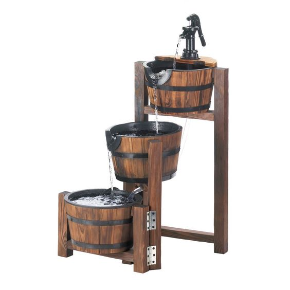 This beautiful three-tiered fountain features apple barrels with black iron banding, and the top has an old-fashioned black iron pump that makes the whole fountain flow with water.  How cool is this????   Oh....and visit us on Facebook!