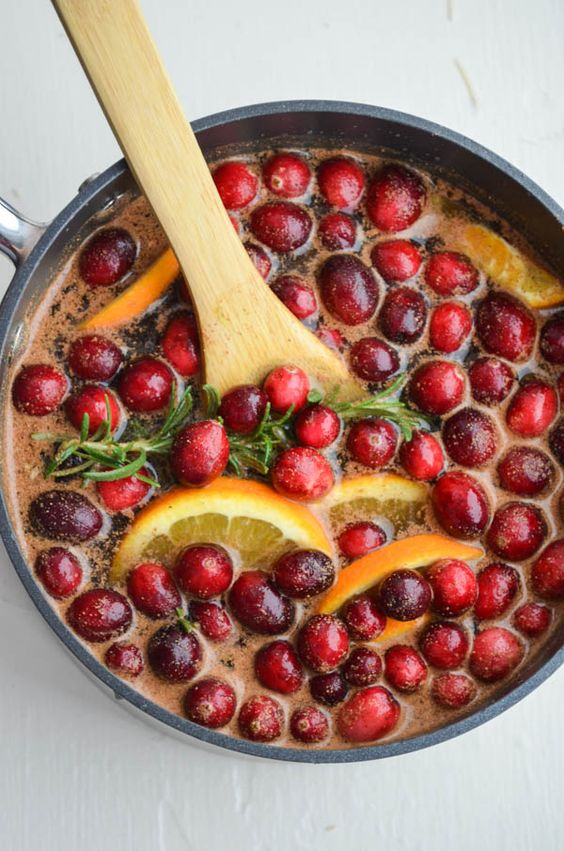 Simmering stovetop potpourri with cranberry, citrus, cinnamon sticks, and rosemary