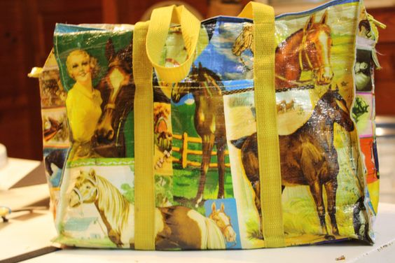 """My Blue Q Horse Bag.....Pretty much waterproof and extremely durable.  Holds lots of """"stuff"""".  You can find them, along with lots of other cool designs at The Curious Peddler in downtown Mebane."""