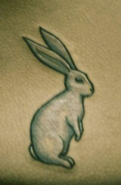 white rabbit tattoo from the matrix i think im adding