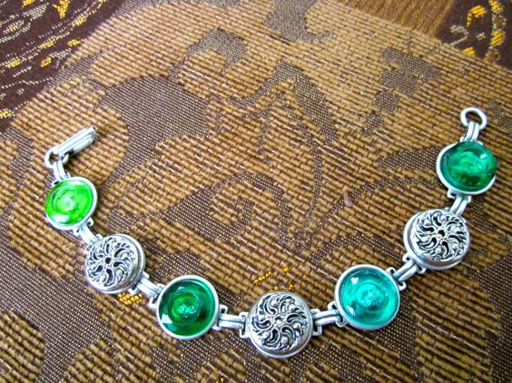 Antique button bracelet, silver twinkle buttons, faceted green glass 2-hole buttons. One of a kind